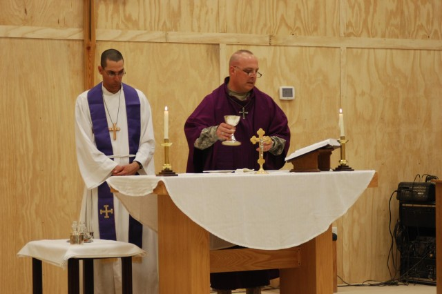 Chaplain (1st Lt.) Barry Malone, Contingency Operating Base Basra hospital chaplain, and Chaplain (Lt. Col.) Tim Mallard, 1st Infantry Division chaplain, conduct the celebration of the Eucharist during the first liturgical Protestant service on COB Basra.