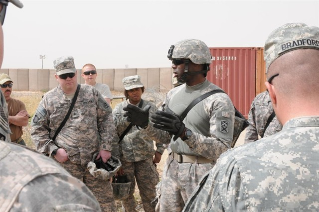 Sgt. Dwayne T. Dubose, a team leader with the 2101st Transportation Company out of Demopolis, Ala., 541st Combat Sustainment Support Battalion, 15th Sustainment Brigade, 13th Sustainment Command (Expeditionary) and an Ozark, Ala., native, talks to fellow Soldiers about what to look for in improvised explosive devices during the counter-improvised explosive device level 3, train-the-trainer course March 31 at Contingency Operating Base Speicher, Iraq.