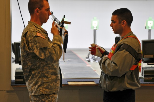 FORT BENNING, Ga.--Spc. Joe Hein, U.S. Army Marksmanship Unit, instructs Staff Sgt. Kenny Griffith, Warrior Transition Brigade, Fort Hood, Texas, on proper positioning with an air rifle Mar. 30 at Pool Indoor Range. Griffith was among 16 Wounded Warriors who came to Fort Benning to get rifle and pistol training from the experts of the USAMU in preparation of the Warrior Games, an inaugural event being held May 10-14 at the Olympic Training Center. (Photo by Michael Molinaro, USAMU PAO)