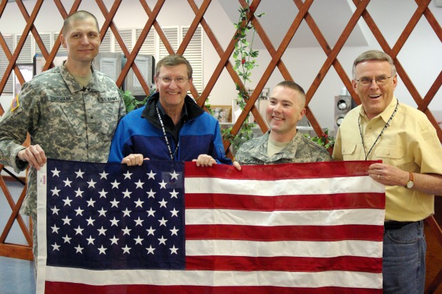 Brig. Gen. Al Dohrmann, Bismarck, N.D., commander of Multi-National Battle Group-East, and North Dakota Sentors Byron Dorgan and Kent Conrad pose with Sgt. Samuel Hemphill, Bismarck, N.D. at Camp Bondsteel, Kosovo, April 4.  The senators presented Hemphill a flag flown over the U.S. Capitol in recognition of the actions he took to save the life of an injured Kosovo resident in December 2009.