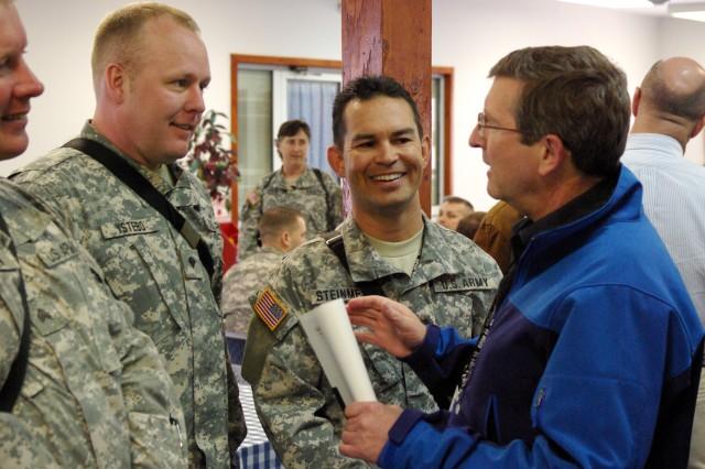 North Dakota Senator Kent Conrad talks with Spc. Chad Ystebo and Sgt. Jon Steinmetz, both of Fargo, N.D., during a visit to Camp Bondsteel, Kosovo, on April 4.