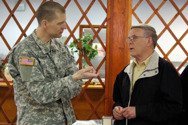 Brig. Gen. Al Dohrmann, Bismarck, N.D., commander of Multi-National Battle Group-East, talks with North Dakota Senator Byron Dorgan during Dorgan's visit to Camp Bondsteel, Kosovo, on April 4.