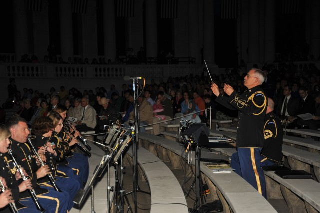 """Col. Thomas Rotondi, Jr., leader and commander of the U. S. Army Band """"Pershing's Own,"""" leads the band and The U.S. Army Chorus with the music at the Easter Sunrise Service, Arlington National Cemetery Amphitheater on April 4, 2010."""