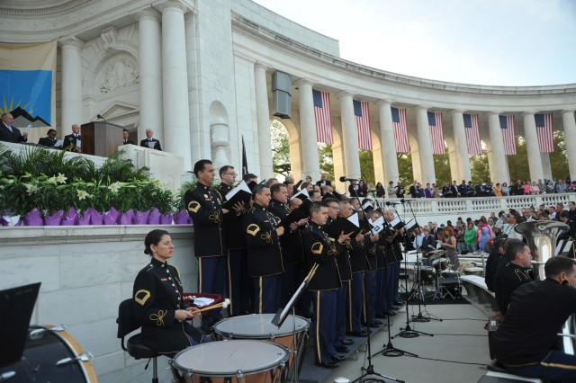 Members of The U.S. Army Chorus sing during the Easter Sunrise Service , Arlington National Cemetery Amphitheater on April 4, 2010.