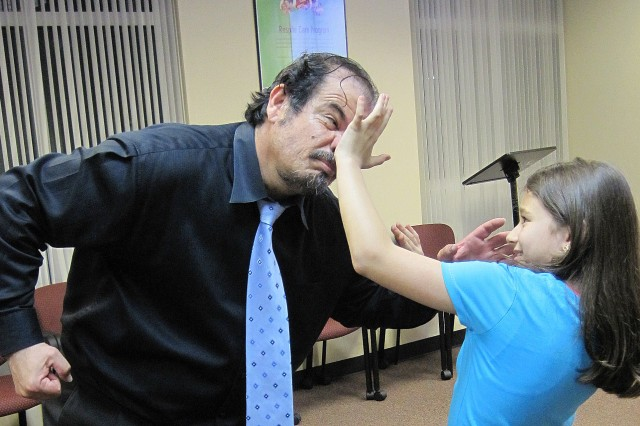 """A young member of Luis Rivera's Self Defense Class learns how to strike a painful blow at a much larger attacker. """"As important as everything else is the technique, basically applying hard bone to soft tissue,"""" he said. """"You must be able to disable the other person,"""" Rivera said."""