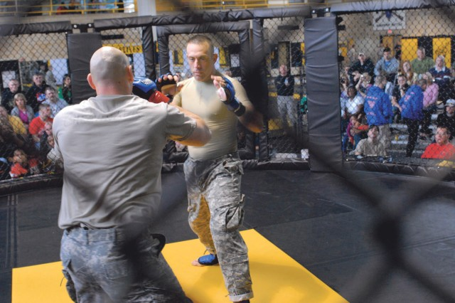 Staff Sgt. Steven Elliot, right, of the California National Guard locks up with Sgt. 1st Class Ryan Chroninger of the Idaho National Guard during Sunday's cruiserweight title match at the Army National Guard Combatives Tournament.