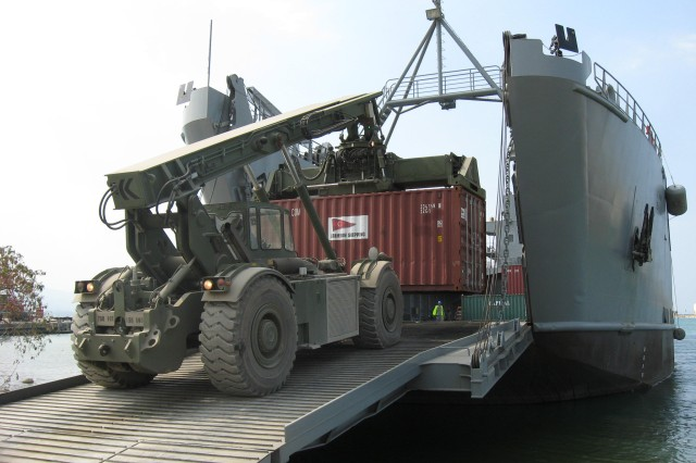 A container is offloaded at the Sea Port of Debarkation in Port-au-Prince, Haiti. SDDC's Lt. Col. Ralph Riddle led the team that not only reopened the seaport, but tripled its throughput from pre-quake levels.