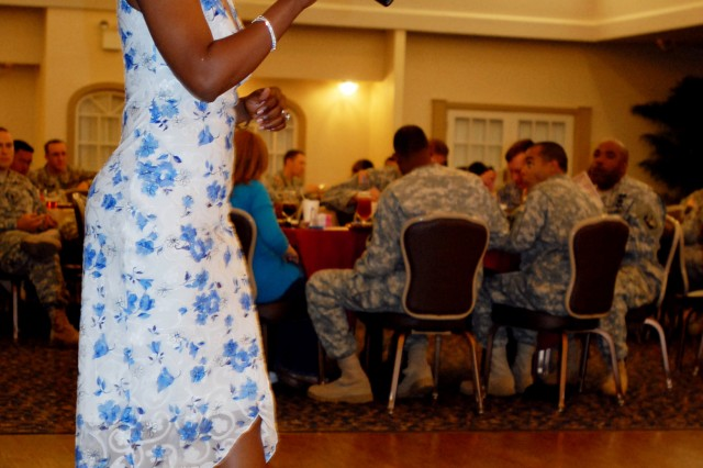 "Sgt. Maria Gooding captivates the 4th Sustainment Brigade, 13th Sustainment Command (Expeditionary) audience as she performs the song ""At Last"", in celebration of the 30th anniversary of Women's History Month, in the Club Hood ballroom at Fort Hood, Texas Mar. 30. (U.S. Army photo by Pfc. Amy M. Lane)"