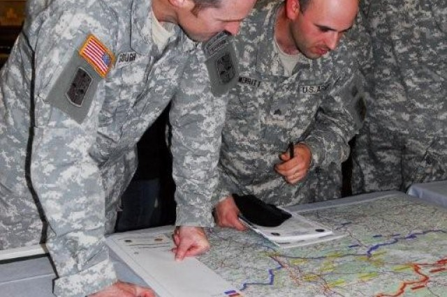Lt. Col. Jamie Gough, deputy commanding officer, 172nd Infantry Brigade, discusses possible housing options in the Grafenwoehr area with Sgt. Josef Merritt, a cavalry scout with Headquarters Company, 1st Battalion, 2nd Infantry Regiment. Soldiers of TF 1-2 will begin moving to Grafenwoehr this spring.