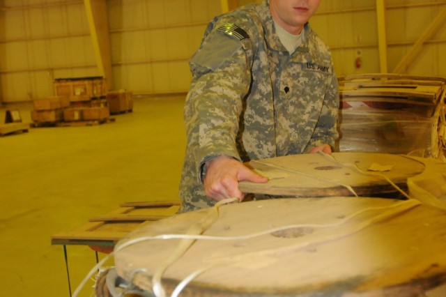 Spc. Todd Boban, a Supply Support Activity storage clerk with the 716th Quartermaster Company, 80th Ordnance Battalion, 15th Sustainment Brigade, 13th Sustainment Command (Expeditionary) and a Pittsburgh native, moves cargo off a pallet at the SSA March 23 at Joint Base Balad, Iraq. JBB has the largest SSA operation in the Army. (U.S. Army photo by Spc. Michael Camacho)
