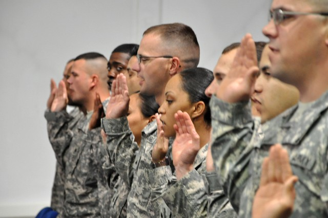 Noncommissioned officers with the 15th Sustainment Brigade recite the Charge of the Noncommissioned Officer during an induction ceremony here March 31. During the ceremony, 48 NCOs were inducted into the Army's NCO corps. (U.S. Army photo by Staff Sgt. Rob Strain, 15th Sustainment Brigade Public Affairs)