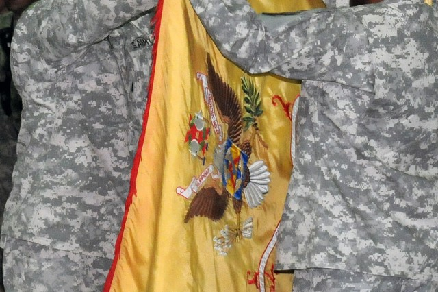 Lt. Col. Steven S. DeBusk, 264thth Combat Sustainment Support Battalion, 15th Sustainment Brigade, 13th Sustainment Command (Expeditionary), commander, and Command Sgt. Maj. Melvin E. Rutledge, the battalion's sergeant major, case their unit's colors to symbolize the end of their Iraq tour at a transfer of authority ceremony at the main gym here, April 1. (U.S. Army photo by Staff Sgt. Matthew C. Cooley, 15th Sustainment Brigade public affairs)