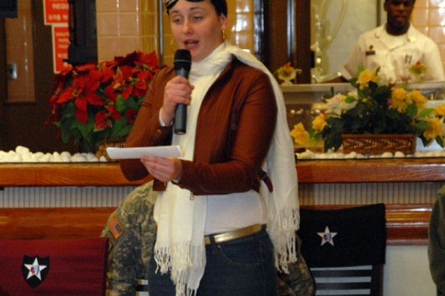 Pfc. Gabrielle Flowers portrays Amelia Earhart during a women's history observance March 31.