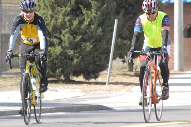 Richard Gash edges past Jason Hester during the 30 Kilometer bicycle race held on Casey Garrison April 3. Gash's time was 52:48 and Hester's time was 52:49 both men competed in the Men's Division 35 years and under. Gash placed overall 1 and 1 for Men's Division 35 years and under.