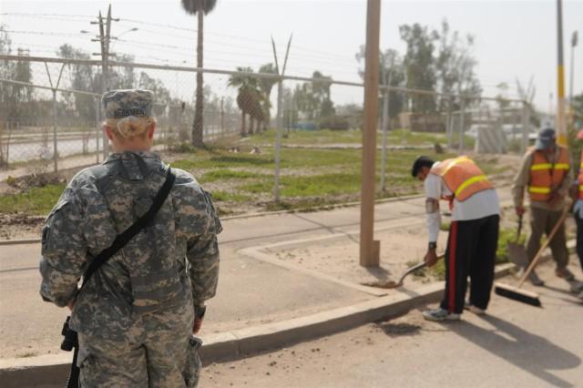 Michigan Guardsmen escort Iraqi workers at JBB