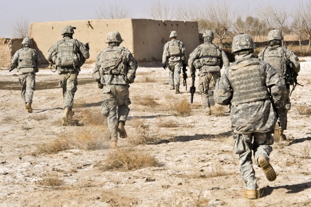 In this file photo, Soldiers respond to an attack while conducting a patrol in a field during Operation Helmand Spider in Badula Qulp in Helmand province, Afghanistan, Feb. 15, 2010. Beginning in May, some 50 Army and Air Force Exchange Service contracted concessions in Afghanistan are slated for closure.