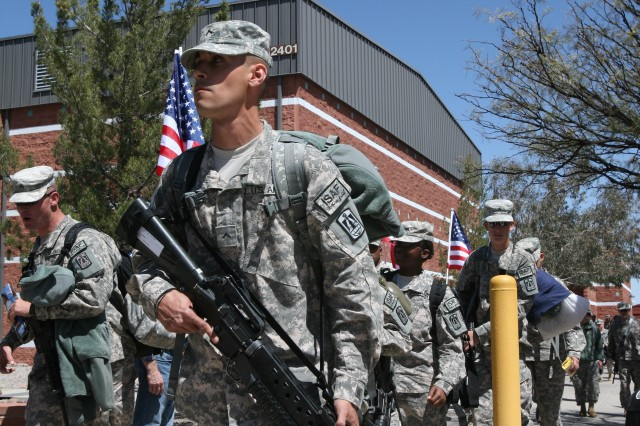 An 86th Expeditionary Signal Battalion Soldier departs Eifler Gym, following a departure ceremony for the Soldiers.