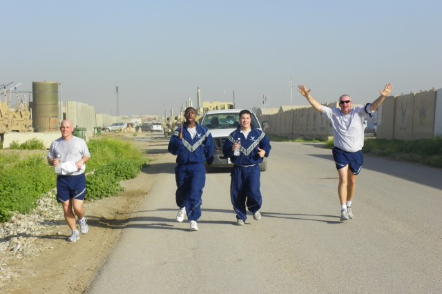 Airmen race to the finish line during the April 1 Fun Run on Forward Operating Base Warrior, Iraq.