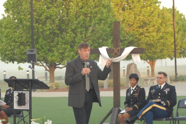 Retired Army Chaplain (Col.) Scott McChrystal delivered the Easter message to a standing-room only crowd, at Marne Garden, April 4. Seated and looking on near the ceremoniously draped cross are Chaplain (Capt.) Stephanie Handy and Chaplain (Col.) Warren Kirby.