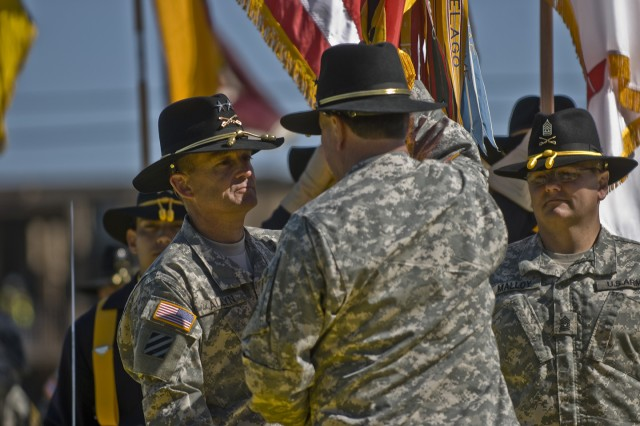 FORT HOOD, Texas-Maj. Gen. Daniel Allyn (left), receives the 1st Cavalry Division's colors from Gen. Charles Campbell, commander, Forces Command, signifying his role as the division's new commander.  Allyn, from Berwick, Maine, comes to the 1st Cav. Div. from the XVII Airborne Corps at Fort Bragg N.C.