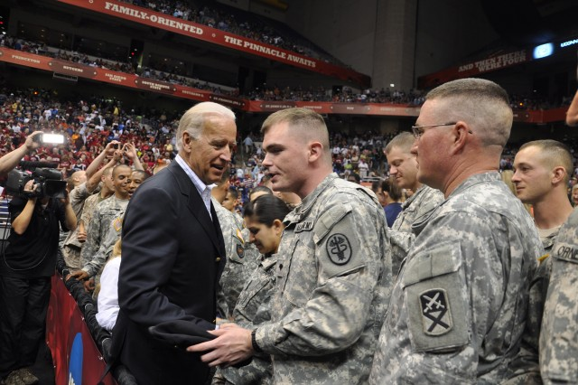 Vice President Joseph Biden meets military personnel from Fort Sam Houston at the Alamodome in San Antonio during the Women's NCAA Final Four basketball game April 6. More than 100 military personnel representing the Army, Marine Corps, Navy, Air Force and Coast Guard participated in the military salute at the opening ceremony prior to the game. During halftime Biden met Soldiers, shook their hands and posed for pictures with them.