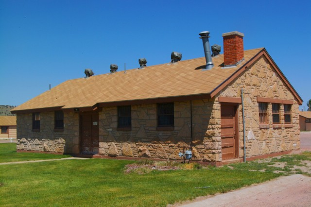Building 301 is an excellent example of the unique historic stonework in Camp Guernsey's cantonment area. Buildings like these were constructed with locally quarried sandstone as Works Progress Administration projects in the New Deal era. The CRM office developed presentations highlighting these historic structures for the 75th anniversary of the New Deal in 2008.