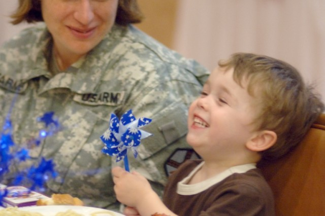 Spaghetti dinner Maj. Jennifer Farmer, Office of the Staff Judge Advocate and her son, Austin, 2, share a moment of laughter at the Month of the Military Child Spaghetti Dinner Kickoff Tuesday at Fort Belvoir's Community Center.