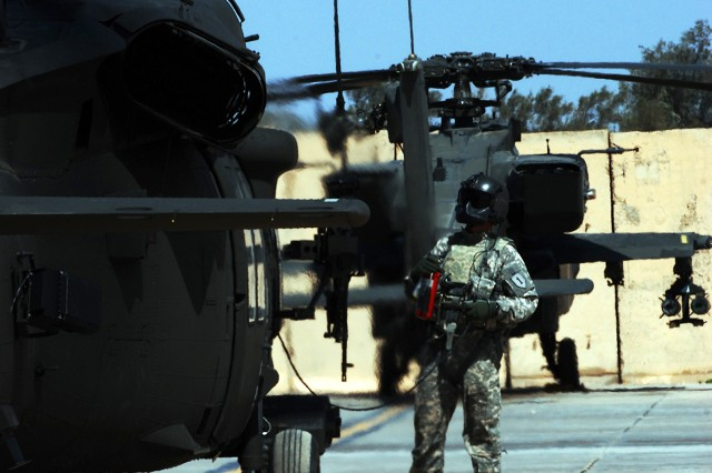 BAGHDAD - A crew chief with Combat Aviation Brigade, 1st Infantry Division watches his aircraft as it shuts down on Camp Taji airfield March 30. (U.S. Army photo by Spc. Roland Hale, Combat Aviation Brigade, 1st Infantry Division, USD-C)