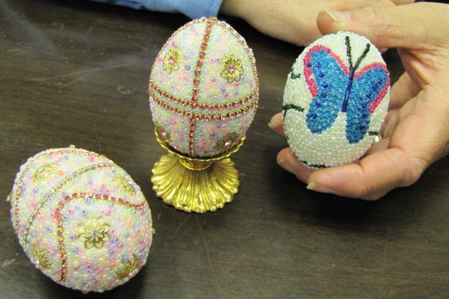 The soft hues of pink and purple along with butterflies and flowers are all aglitter on these eggs designed and decorated by Mike Chemsak, chief of recreation for Family and Morale Welfare and Recreation.
