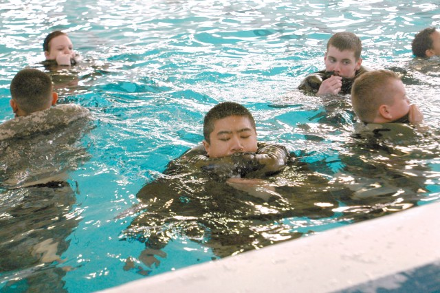 Learning to be resourceful is a crucial aspect of Water Survival. These junior cadets learn how to use their uniform to conserve energy at the JCLC March 31 at Keeler Pool on JBLM Lewis Main.