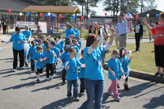 The Army Strong Beginnings Pre-K class proudly serves as the caboose of the parade.