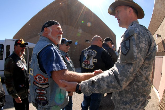 Stephen Wright, a Vietnam veteran from Helendale, Calif., shakes hands with Lt. Col. Scott Coulson, deputy commander of 11th Armored Cavalry Regiment, at Fort Irwin, Calif., on April 7. Wright, along with 169 other Vietnam War-era veterans, was attending the Fort Irwin Welcome Home Day Ceremony for Vietnam War veterans.