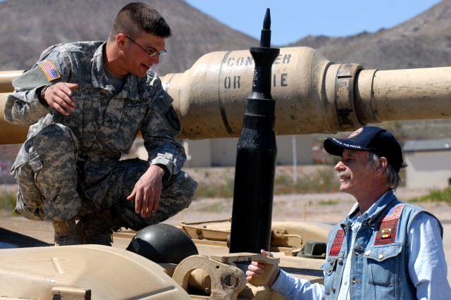 Patrick Donaldson, (right), a veteran of the Vietnam War who served as a Marine rifleman from 1968-69, speaks with Pvt. Justin Cate, a tank driver with C Troop in the 1st Squadron of the 11th Armored Cavalry Regiment. Donaldson viewed static displays of equipment of the 11th ACR as a guest of the Fort Irwin Welcome Home Day Ceremony for Vietnam War veterans held April 7.