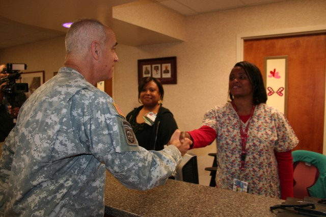 Chief of the Army Medical Service Corps Maj. Gen. David A. Rubenstein greets receptionists in Blanchfield Army Community Hospital's (BACH) Specialty clinic April 9 as he visited clinics throughout the hospital.