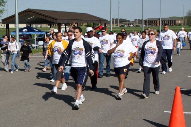 Soldiers, Families and local community residents walk around Fort Campbell's Division Parade Field Saturday, April 10 during the inaugural Walk for Autism in support of National Autism Awareness Month.