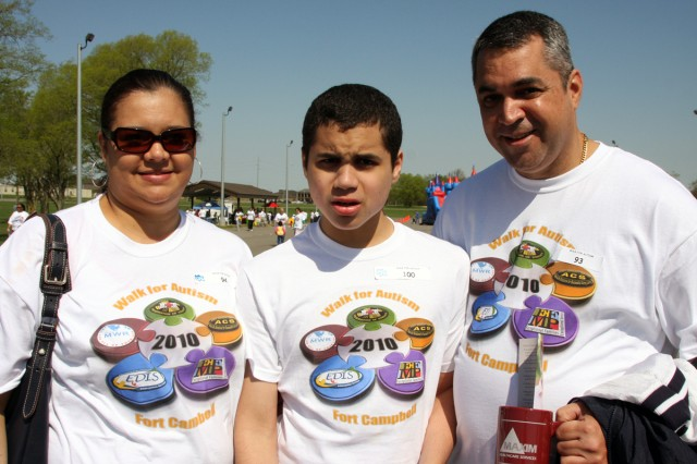 "Joann Aquino participated in the Walk for Autism at Fort Campbell's Division Parade Field Saturday, April 10, with her son Ricardo and her husband Santos. The Aquino family has lived in the area for thirteen years and appreciates all that Blanchfield Army Community Hospital's Exceptional Family Member Program has done for them and their son Ricardo, who has autism. ""Everyone has been very supportive, even helping us navigate the school system and finding resources in the community,"" Joann Aquino said."