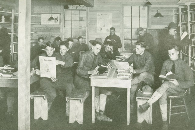 "Popular past time: This image shows ""doughboys' relaxing in their camp library.  WWI Signal Corps Collection)."