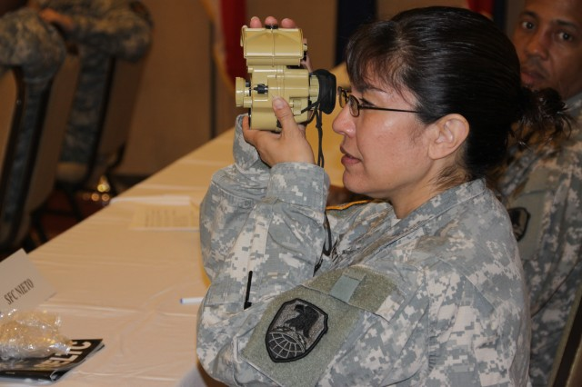 Sgt. 1st Class Katherine Nieto tests out a piece of equipment during the Senior Enlisted Leaders Training Conference held March 22-25 at Cocoa Beach, Fla.