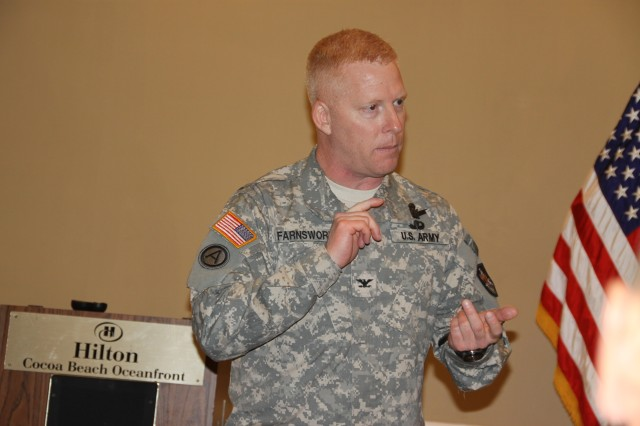 Col. Jeffrey Farnsworth, commander, 1st Space Brigade, provides a brigade year-in-review brief to attendees of the U.S. Army Space and Missile Defense Command/Army Forces Strategic Command Senior Enlisted Leaders Training Conference held March 22-25 at Cocoa Beach, Fla.