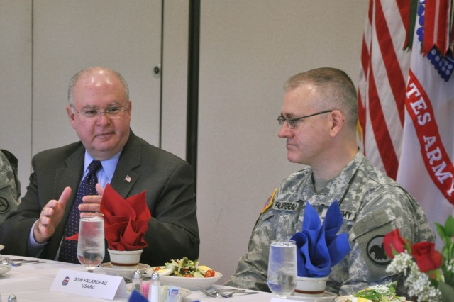 Army Under Secretary Joseph W. Westphal speaks with Sgt. Maj. Troy Falardeau, a Soldier assigned to U.S. Army Reserve Command (USARC), about his experience as a deployed public affairs Soldier during the lunch segment of the Army under secretary's official visit to Fort McPherson. .