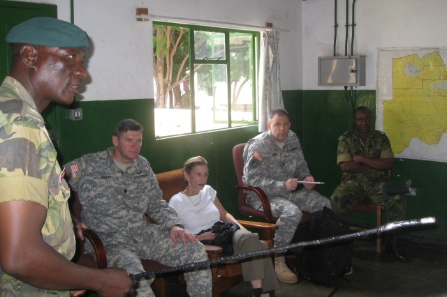KASANE, Botswana - Task Force Commander Maj. Israel Mbangwe, 15 Infantry Battalion, Botswana Defence Force, briefs Ambassador Vicki Huddleston, the Deputy Assistant Secretary of Defense for Africa on operations in the Chobe Sub Sector of northern Botswana during her first visit to the country in early April 2010. Ambassador Huddleston paid a visit to the headquarters at Kasane to become more familiar with BDF operations, including anti-poaching operations intended to protect Botswana's diverse wildlife from predation.