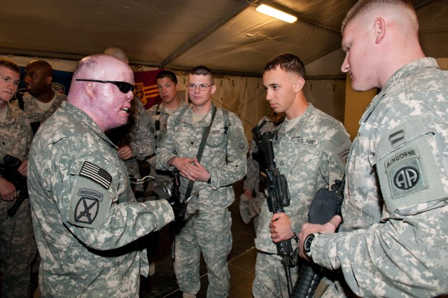 Retired Sgt. 1st Class Michael Schlitz, a veteran who was severely injured by an improvised explosive device in Baghdad during the troop surge, talks to paratroopers at Al Asad Air Base, Iraq, about suicide prevention. Schlitz told his audience that it was their responsibility to take care of their battle buddies' emotional health.
