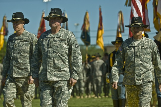 FORT HOOD, Texas-Reviewing officer for the 1st Cavalry Division's Change of Command Ceremony, Gen. Charles Campbell (foreground), escorts outgoing 1st Vav. Div. Commander Maj. Gen. Daniel Bolger (left), and 1st Cavalry Division's newest commander, Maj. Gen. Daniel Allyn, off of Fort Hood's Cooper Field during the division's Change of Command Ceremony April, 8.