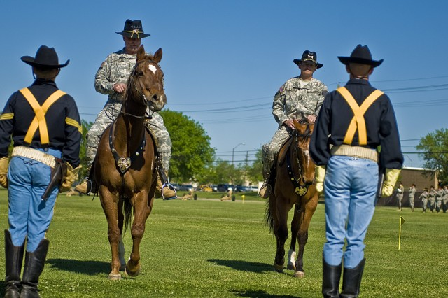 FORT HOOD, Texas-Soldiers from the 1st Cavalry Division's Horse Cavalry Detachment wait for reviewing officer, Gen. Charles Campbell (left), and the newest 1st Cavalry Division commander, Maj. Gen. Daniel Allyn, to dismount their horses after pass and review during the 1st Cav. Div. Change of Command Ceremony April, 8 here, at Fort Hood.