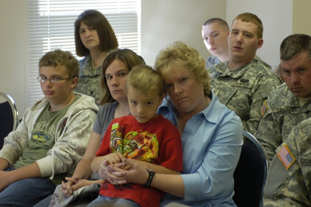 RAINELLE, W.V. (April 10, 2010) - Soldiers and family members of the 811th Ordnance Company here listen to a briefing from state and local representatives prior a discussion about concerns with healthcare, mobilization, training and employer relations at the U.S. Army Reserve Center here. Army leaders and state and local representatives hope to change old policies to match up with modern responsibilities to Soldiers, such as providing tax breaks to Soldiers' employers during deployments in an effort to improve community support. (U.S. Army photo by Spc. Michael T. Crawford, 316th ESC Public Affairs Office)