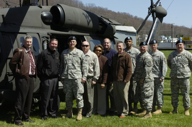 RAINELLE, W.V. (April 10, 2010) - State and local representatives stand with Army leaders beside a UH-60 Blackhawk outside the U.S. Army Reserve Center here. Leaders and representatives met with Soldiers with the 811th and their families to discuss concerns with healthcare, mobilization, training and employer relations. Among those pictured are John Newman, senior advisor to the assistant secretary of the Army for Manpower and Reserve Affairs; Col. Robert M. Pelletier, commander of the 38th Regional Support Group; Ret .Col. David Mitchell, Army Reserve ambassador for West Virginia; Capt. James B. Turman, commander of the 811th Ordnance Company; Master Sgt. James Sater, acting first sergeant for the 811th Ordnance Company; and Lt. Col. John Paul H. Cook, military assistant for AC/RC integration and representative for Congressman Nick J. Rahall.(U.S. Army photo by Spc. Michael T. Crawford, 316th ESC Public Affairs Office)