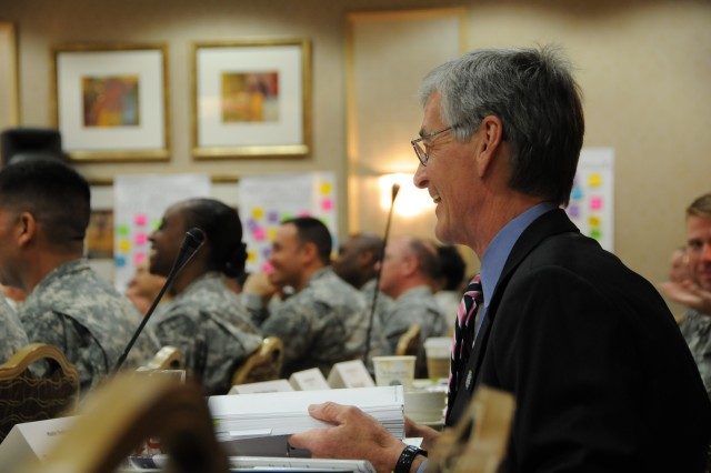 Secretary of the Army John McHugh listens in on an Army Master Resilience Trainer course at the University of Pennsylvania April 13, where he spoke with students and instructors and got a taste of the Army's newest wellness initiative.