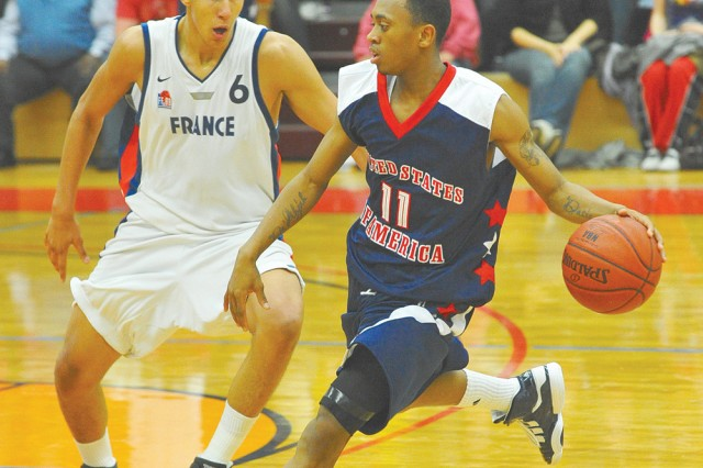 U.S. player, Ryan Boatright, blows by a member of the French team during a preliminary round of play April 4. France beat the U.S. 67-66. Team Australia went to take the top spot and capture the tournament title.