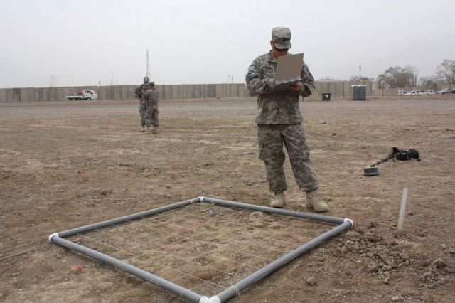 BAGHDAD - Staff Sgt. Timothy Torrey from Haverhill, Mass., assigned to Headquarters Support Company, 101st Eng. Bn., uses a grid to determine that all of the training mines in an area were properly marked, on the Victory Base Complex March 26. Torrey trains Soldiers how to properly identify mines in both daytime and nighttime environments.  (U.S. Army photo by Spc. Brian Johnson, 1434th Eng. Co., 16th Eng. Bde., USD-C)