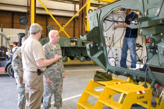 Command Sgt. Maj. Clinton Hall observes Stryker repair work during his visit to Anniston Army Depot April 6.